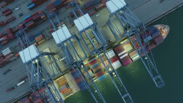 Aerial Top View, Working Crane and Container Ship in the Harbor, International Cargo Port