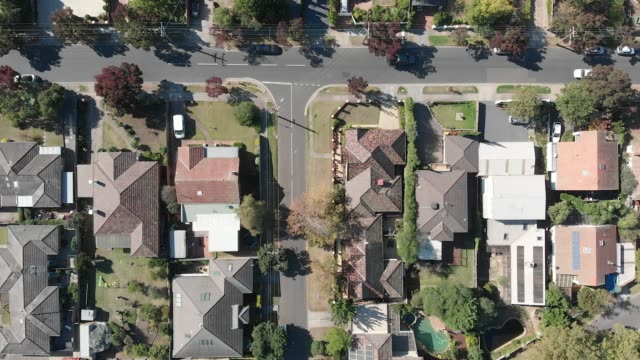 4k aerial topdown view of street and houses in the suburbs of melbourne - urban road stock videos & royalty-free footage
