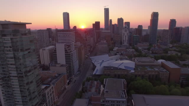 4k aerial toronto: fly over downtown at sunrise - toronto stock videos and b-roll footage