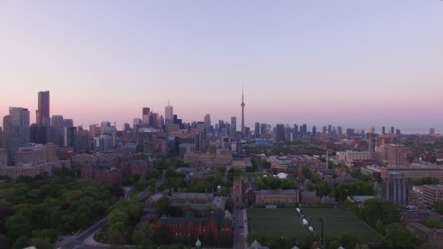 4k aerial toronto: fly towards downtown at sunrise - toronto stock videos and b-roll footage
