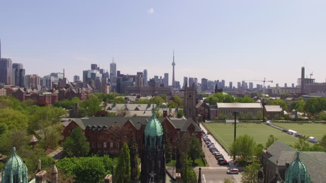 4k aerial toronto: skyline pan up - tilt up stock videos & royalty-free footage
