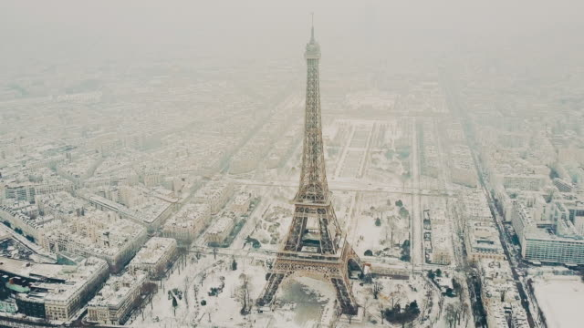 aerial tour eiffel, paris under snow - eiffel tower stock videos & royalty-free footage