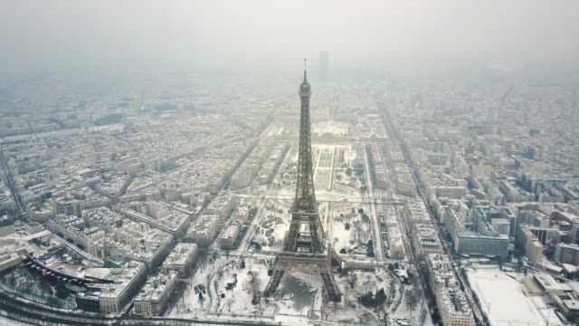 aerial tour eiffel, paris under snow. - paris france stock videos & royalty-free footage
