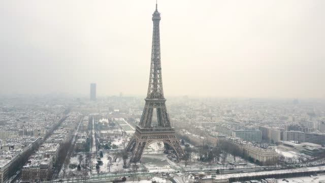 aerial tour eiffel, paris under snow. - eiffel tower paris stock videos & royalty-free footage