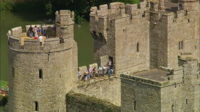 vidéos et rushes de aerial tourists visiting bodiam castle / east sussex, england - chateau