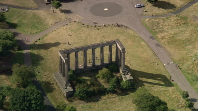 aerial tourists visiting national monument / zoom out view of calton hill east of central edinburgh - calton hill national monument stock videos and b-roll footage