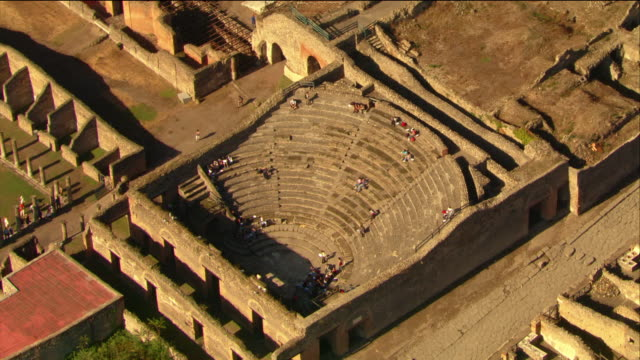 aerial tourists visiting odeon theatre and palaestra / pompeii - old ruin stock videos & royalty-free footage