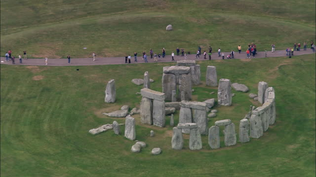 aerial tourists walking near stonehenge/ wiltshire, england - stonehenge stock videos and b-roll footage