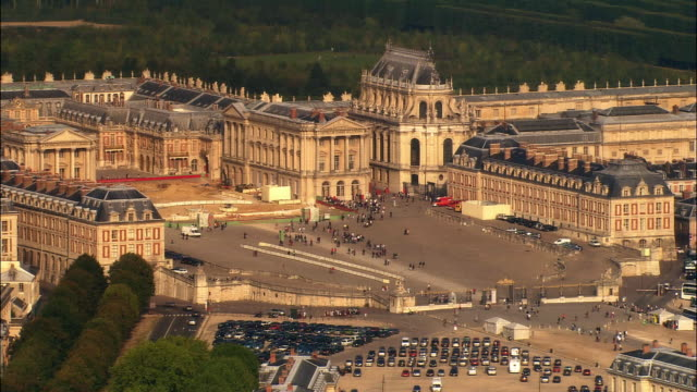 aerial ws tourists walking outside chateau de versailles entrance across from parking lot / versailles, ile-de-france, france - chateau de versailles stock videos and b-roll footage