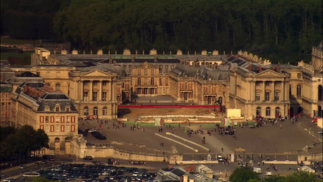 aerial ws tourists walking outside chateau de versailles entrance / versailles, ile-de-france, france - chateau de versailles stock videos and b-roll footage