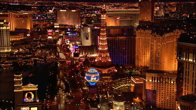 aerial toward paris las vegas on the strip at night / passing by replica of eiffel tower / las vegas, nevada - replica eiffel tower stock videos & royalty-free footage