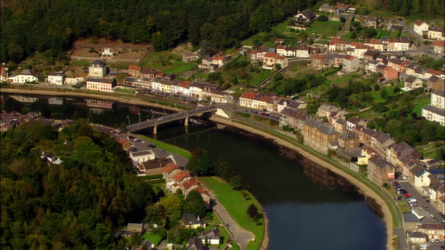 vidéos et rushes de aerial ws town of montherme on meuse river / montherme, ardennes, france - valley