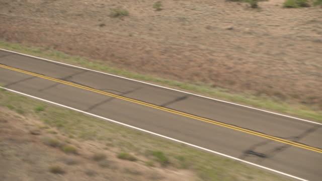 stockvideo's en b-roll-footage met aerial track along an empty road in us desert. - ruimte exploratie