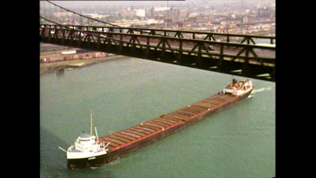 aerial track along bridge with ship underneath; detoir, 1972 - detroit michigan stock videos & royalty-free footage