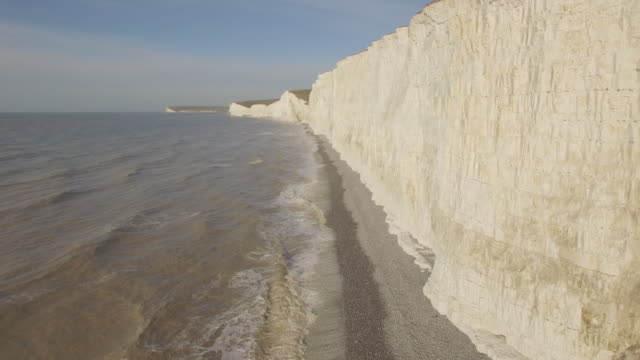 aerial track along chalk cliffs in sussex - english channel stock videos and b-roll footage