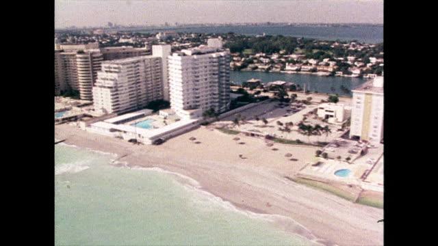 aerial track along miami beach coastline; 1980 - miami stock videos & royalty-free footage