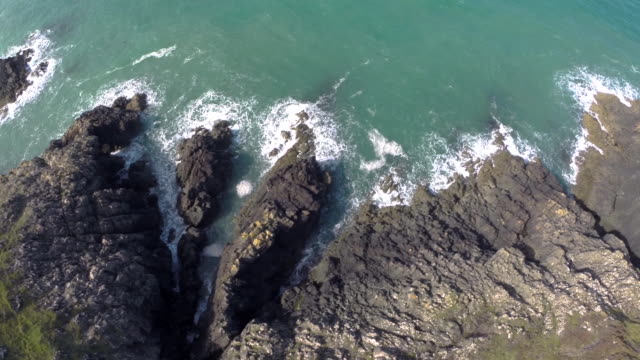 aerial track along pembrokeshire cliffs coastline - pembrokeshire stock videos and b-roll footage