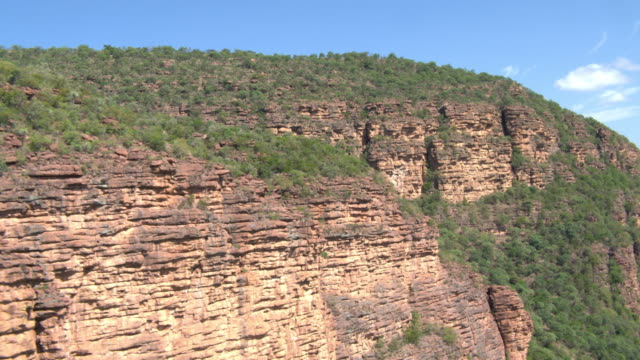aerial track along rock face in waterberg biosphere - rock face stock videos & royalty-free footage