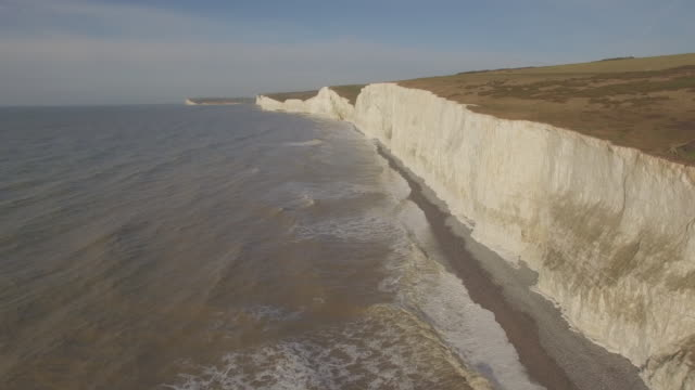 aerial track along seven sisters cliffs in sussex - english channel stock videos and b-roll footage