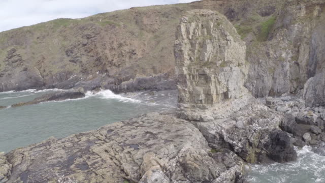 stockvideo's en b-roll-footage met aerial track around cliff stack, pembrokeshire - pembrokeshire