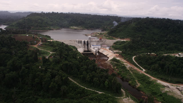 aerial track around dam, cambodia. - forestry industry stock videos & royalty-free footage