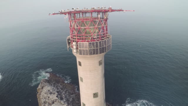 aerial track around the smalls lighthouse - basalt stock videos & royalty-free footage