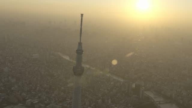 aerial track around tokyo skytree at sunset, japan. - スカイツリー点の映像素材/bロール