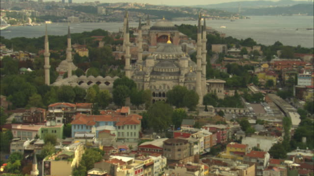 aerial track from sea to hagia sophia and suleymaniye mosques in istanbul - suleymaniye mosque stock videos and b-roll footage