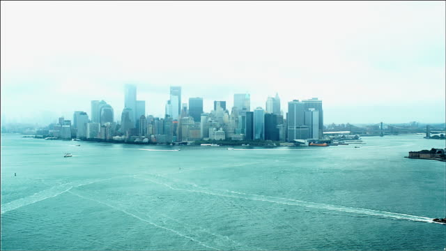aerial track of manhattan island south end, new york. foggy day. - money politics stock videos & royalty-free footage