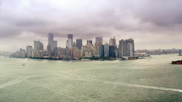 aerial track of manhattan island south end, new york. with rain - money politics stock videos & royalty-free footage