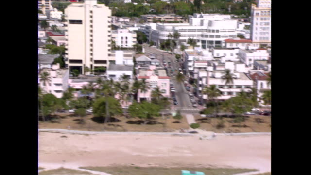 aerial track of miami's historic art deco district; 1992 - south beach stock videos & royalty-free footage