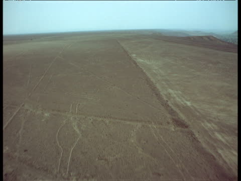 Aerial track over ancient Nazca lines etched out into desert
