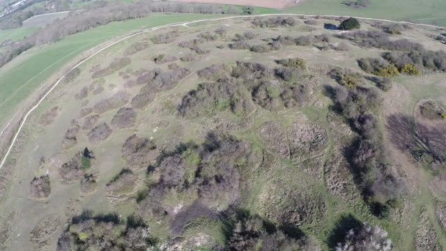 aerial track over cissbury ring - work tool stock videos & royalty-free footage