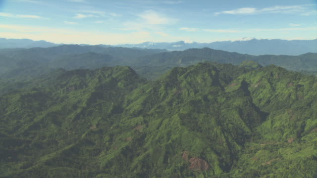 aerial track over forested ridges. - papua stock videos and b-roll footage