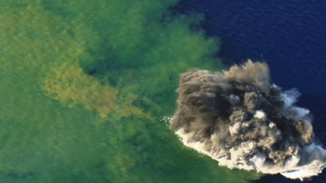 aerial track over kavachi undersea volcano erupting at water surface, solomon islands - eruzione video stock e b–roll