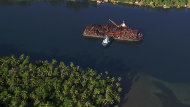 Aerial track over logging barge, Solomon Islands