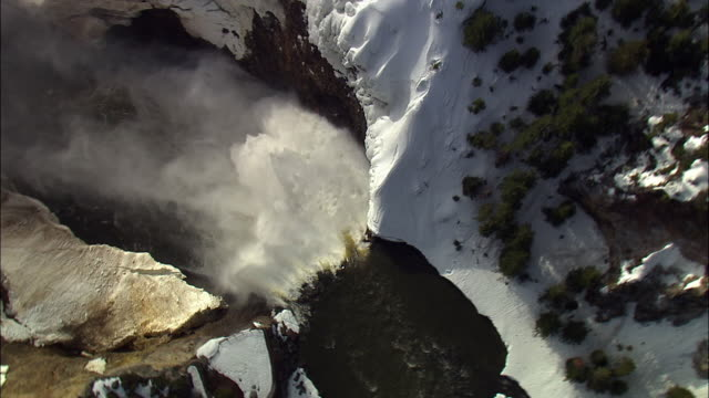 aerial track over lower yellowstone falls in winter, yellowstone, usa - river yellowstone stock videos & royalty-free footage