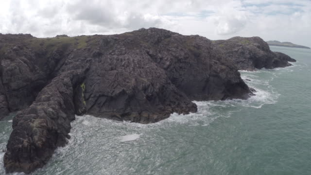 stockvideo's en b-roll-footage met aerial track over pembrokeshire coastline with skomer in distance - pembrokeshire