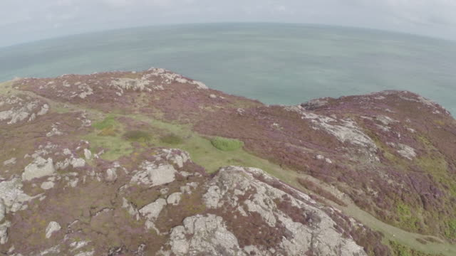 stockvideo's en b-roll-footage met aerial track over pembrokeshire countryside to reveal ocean - pembrokeshire