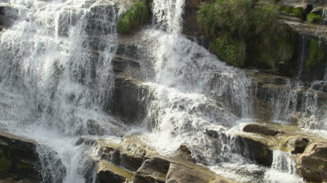 "stockvideo's en b-roll-footage met aerial track over rocky waterfall. - ""bbc natural history"""