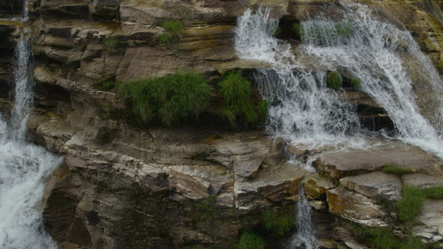aerial track over rocky waterfall. - flowing water stock videos & royalty-free footage