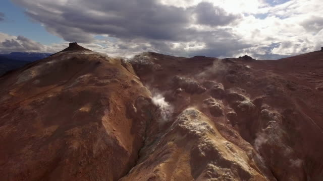 aerial track over rugged brown landscape - rough stock-videos und b-roll-filmmaterial