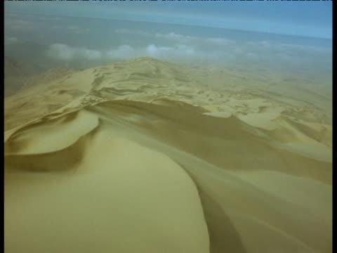 stockvideo's en b-roll-footage met aerial track over sand dunes in atacama desert - ruimte exploratie