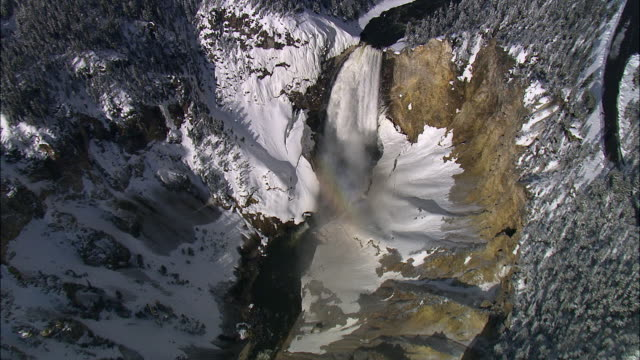 aerial track over snow covered lower yellowstone falls, yellowstone, usa - river yellowstone stock videos & royalty-free footage