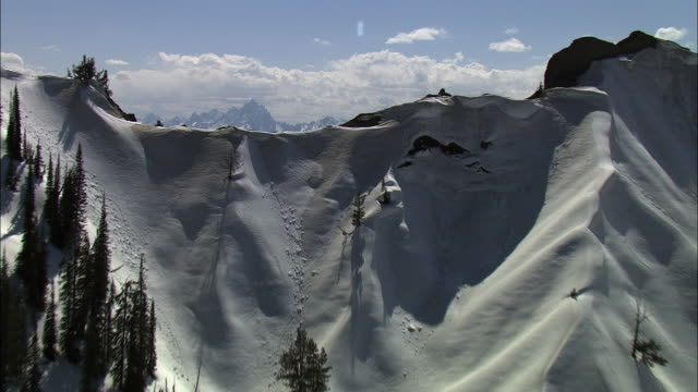 aerial track over snow covered mountain ridge, yellowstone, usa - yellowstone national park stock videos & royalty-free footage