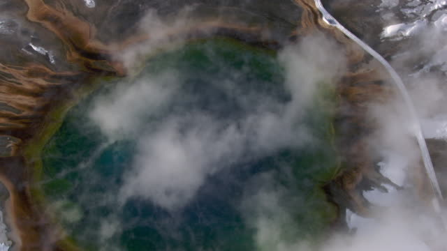 Aerial track over steaming Grand Prismatic Spring, Yellowstone, USA