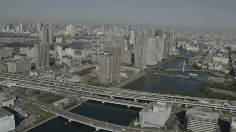 aerial track over tokyo, japan. - urban sprawl stock videos & royalty-free footage