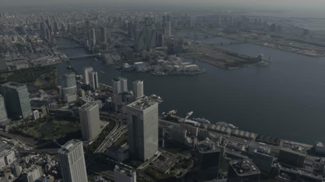 aerial track over tokyo, japan. - tokyo bay stock videos & royalty-free footage
