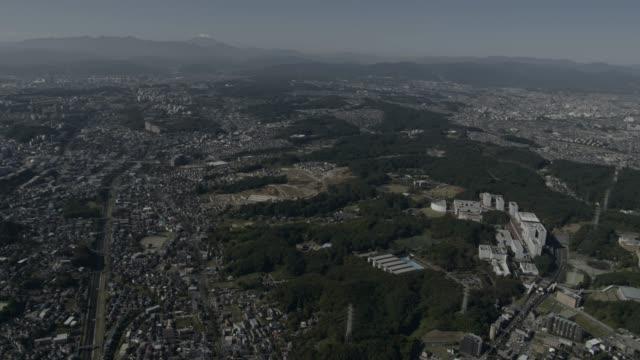 aerial track over tokyo, japan. - vorort wohnsiedlung stock-videos und b-roll-filmmaterial