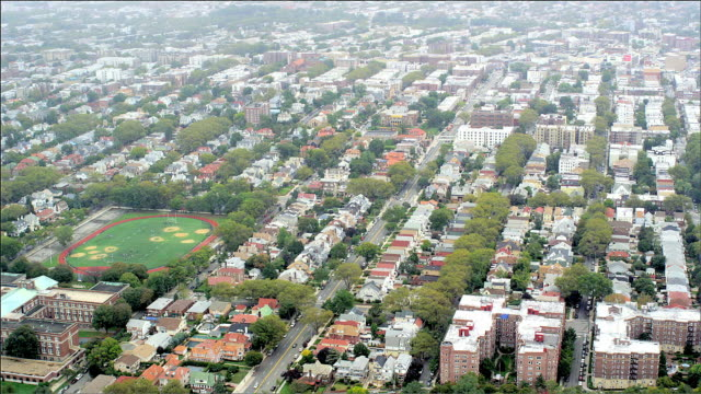 aerial track overwest brooklyn housing and fort hamilton high school. new york. foggy day. - hamilton new york state stock videos & royalty-free footage